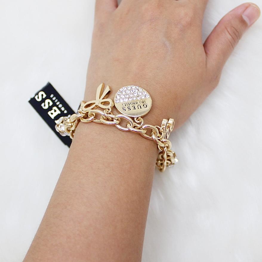 Guess Logo Ribbon Charm Bracelet Gold